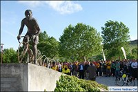 People standing near bicycle statue