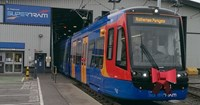 Red, blue and yellow tram
