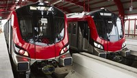 Two red metro trains