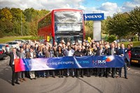 Group of people in front of double-decker bus