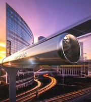 Hyperloop in city at sunset
